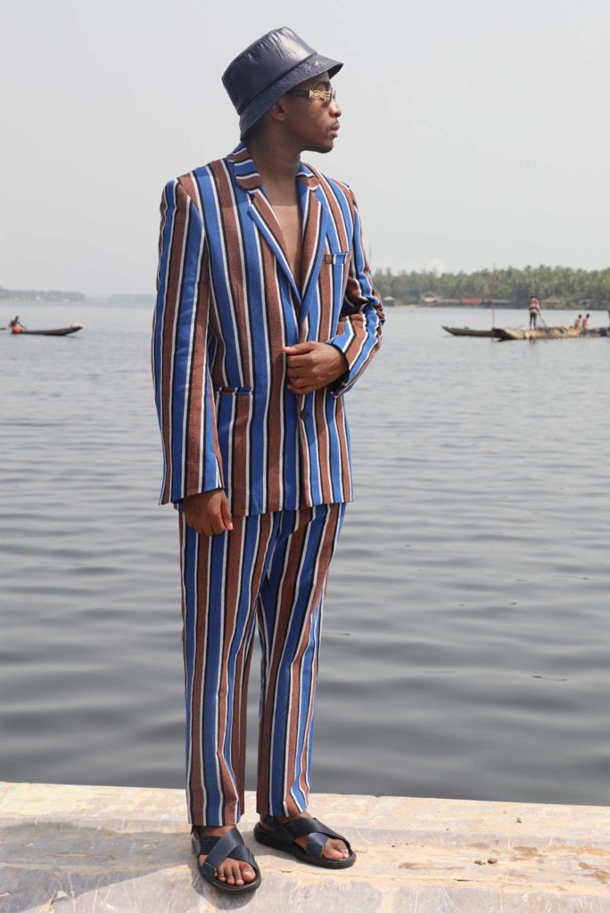 Trevor wearing the Jay striped jacket and love striped pants