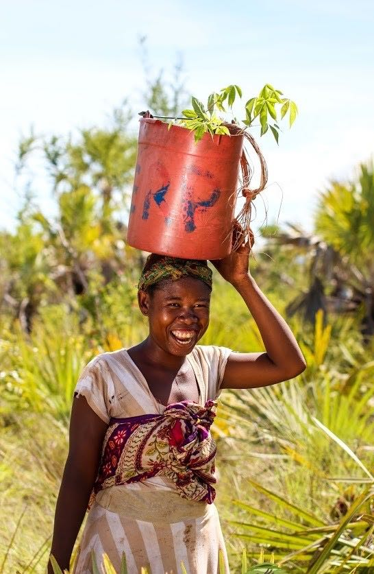 woman carrying a bucket